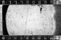 Old filmstrip. Old scratched and damaged grungy negative filmstrip royalty free stock photos
