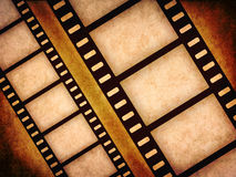 Old filmstrips. Grunge old filmstrips on grungy background Royalty Free Stock Image
