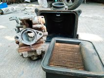 Old filter and carburetor. Air filters Stock Photo