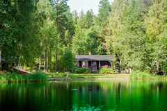 Old Finnish summer cottage at a lake Royalty Free Stock Photos