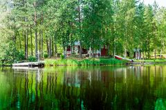 Old Finnish summer cottage at a lake Royalty Free Stock Photography