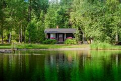 Old Finnish summer cottage at a lake Stock Images
