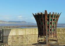 Old fire beacon Lyme Regis Dorset. Old metal fire basket beacon in Lyme Regis Dorset Stock Photo