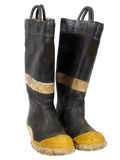Old Fire Boots. Old, worn, tattered, fire boots over white Royalty Free Stock Photo