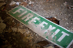 Old fire exit sign on floor Stock Image