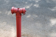 Old Fire hydrant that do not maintenance and operation. Red pipes or red fire hydrant Royalty Free Stock Images
