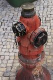 Old fire hydrant in the street Stock Photo