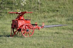 the old fire pump used in the past by firefighters stock photos