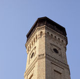 Old fire tower. An old fire tower in the city of Grodno, photographed from below against the sky Royalty Free Stock Image