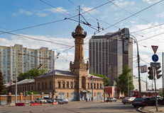 Old fire tower. Moscow, Russia. Fire tower - fire station No. 12 of the Main Department of EMERCOM of Russia. Behind it is a modern hotel Holiday inn. Sokolniki Stock Photo