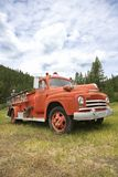 Old fire truck. Low angle view of old fire truck in field Stock Images