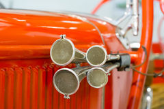 Old fire truck siren. Red metal chassis in behind Royalty Free Stock Photography