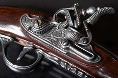 Old firearm. Lock at black background royalty free stock photography