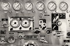 The old firefighter. Detail photo of the instrument panel of an old firetruck displaying the various gages and levers Royalty Free Stock Images