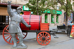 Old firefighter sculpture in Chelyabinsk, Russia. Sculpture of firefighter -one of many on the walking street in Chelyabinsk, called Kirovka. Great tourist place stock image