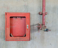 Old firehose and firehose box Royalty Free Stock Photo