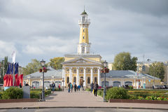 Old firehouse building with the tower on the Susanin square cloud september day. The historic center of Kostroma Stock Photo