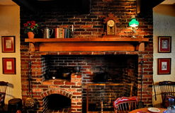 Old fireplace. In a farmhouse dinning room Stock Photos
