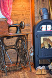 An old fireplace, an antique iron sewing machine. Royalty Free Stock Photography