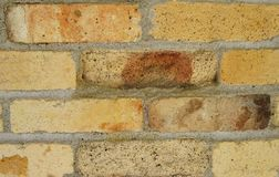 The Old Fireplace Brick. Background of orange, yellow, brown and red multi tone bricks with mortar. Horizontal Royalty Free Stock Image