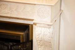 Old fireplace carved and worked detail top corner. An old fireplace carved and worked detail top corner stock images
