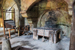 Old fireplace. Medieval stone fireplace in the Abbey of Fontenay, Burgundy, France royalty free stock images