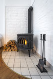Old fireplace in modern interior Royalty Free Stock Photo