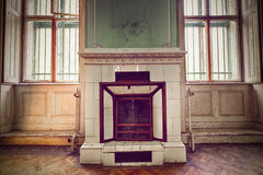 Old fireplace. A very old ornate fireplace in an old building Stock Photos