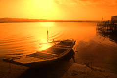 Old fish boat. Old fish-boat on sandy beach with beautiful sunset Royalty Free Stock Photography