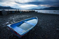 Old fish-boat on beach. Royalty Free Stock Images