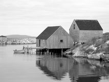 Old Fish Shacks. This is a beautiful black and white photograph of old fishing shacks. Taken at Peggy's Cove, Nova Scotia Stock Photo