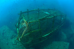 An old fish trap lies on the seafloor Royalty Free Stock Images