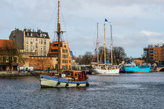 Old fishboat entering Gdansk harbor in Poland Royalty Free Stock Photo