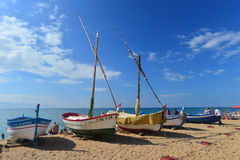 Old fishboats on the beach Stock Photos