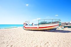 Old fisher boat at the beach at Armacao de Pera in Portugal Royalty Free Stock Photo