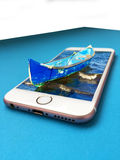 Old fisher boat on  smartphone. Old fisher boat  in a smartphone display 3d Royalty Free Stock Photo