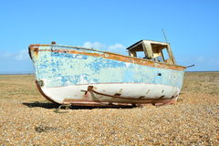 Old fisher man boat. A derelict fisherman's boat on beach Royalty Free Stock Photo