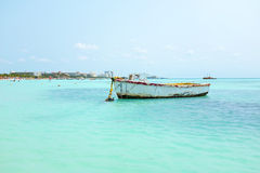 Old fisher's boat at Palm Beach in Aruba in the Carribean Royalty Free Stock Photos