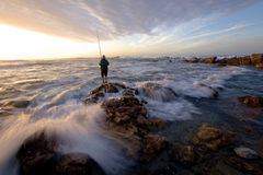 Old fisherman. Try to get an early morning catch Royalty Free Stock Photo