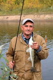 Old Fisherman And His Catch - Zander Royalty Free Stock Photos