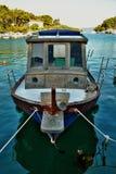 OLD FISHERMAN  BOAT  IN THE BAY , VRBOSKA, HVAR ISLAND Royalty Free Stock Photo