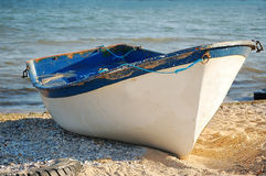 Old fisherman boat on the beach Royalty Free Stock Photos