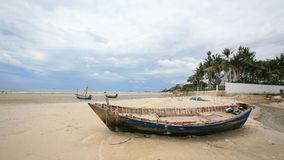 Old fisherman boat on the beach Royalty Free Stock Photography