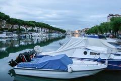 Old fisherman boat in the city centre of Grado Friuli-Venezia Giulia Italy in the evening. Stock Photography