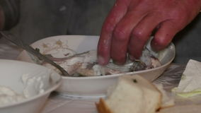 Old fisherman eating fish soup stock video