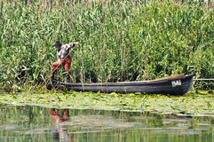 Old fisherman in his boat Royalty Free Stock Images