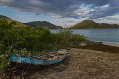 Old fisherman's boat on the tropical beach stock photos