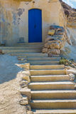 Old fisherman's house. Old fishermen's house built in sandstone cliff Xwejni Bay on the Maltese island of Gozo Stock Photos