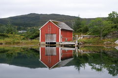 Old fisherman's house, Norway. An old fisherman's house with reflection in the water at the west coast of Norway Royalty Free Stock Image