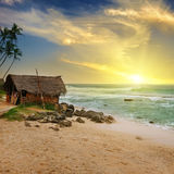 An old fisherman`s hut on the shore of a picturesque ocean and a Royalty Free Stock Images